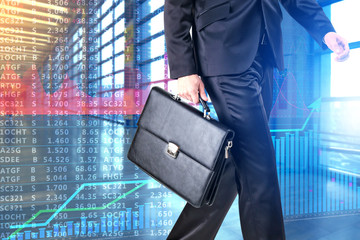 Businessman with suitcase and stock exchange quotes on background