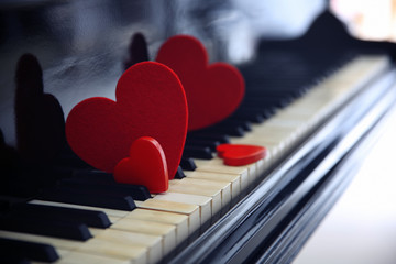 Red hearts on piano keys, close up