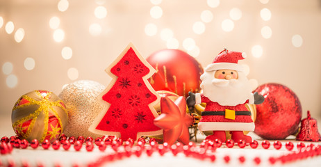 Santa and Christmas tree with ornamenst and balls as holiday background