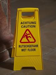 Achtung Rutschgefahr! Caution wet floor!