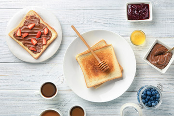 Composition with tasty sweet toasts on wooden table