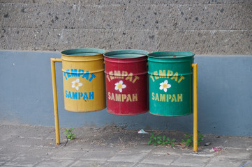 Three recycle bins in Bali. The text means Trash Can