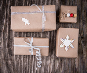 Gift boxes package decorated for Christmas or New Year on rustic wooden background