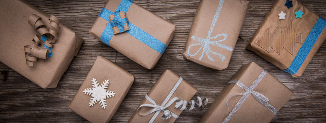 Background of brown paper wrapped gift boxes