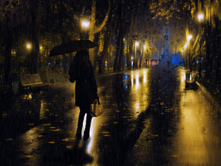 Girl at the night city lights during the rain at the evening