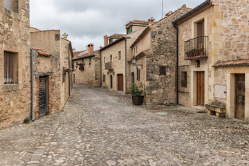 Typical street in the historical town of Pedraza. Segovia. Spain.