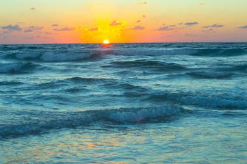 Beautiful sunset on the shtormy sea