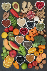 Large super food collection high in antioxidants, vitamins, anthocyanyns, fibre and minerals with fresh fruit, vegetables, seeds, nuts, grains, cereals, pulses, bee pollen grain, herbs and spices.