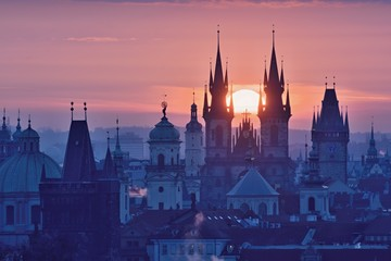 Wall Murals Prague Sun disk between spires of the Prague Old Town Church of Our Lady before Tyn