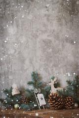 Christmas tree against concrete wall