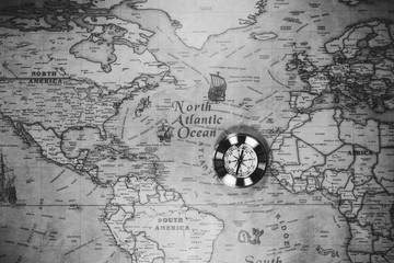 Old compass on vintage map. Adventure stories background. Retro style. The map used for background is in Public domain.