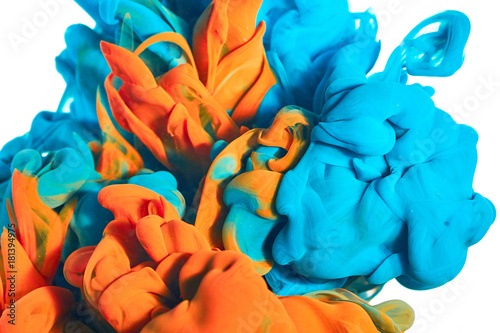 Wall mural ink in the water. A splash of blue and orange paint. Abstract background color