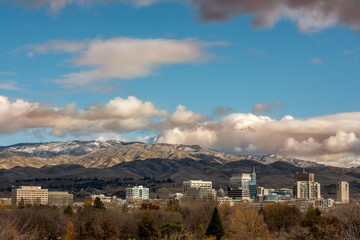Late Fall Boise City skyline with clearing clouds