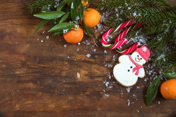 Christmas and New Year composition on dark wooden background with copy space top view.