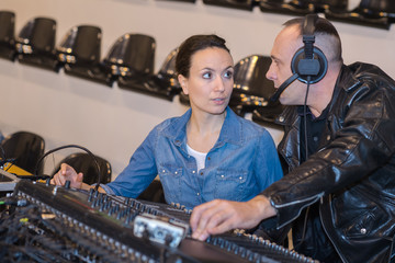 sound engineers at controls