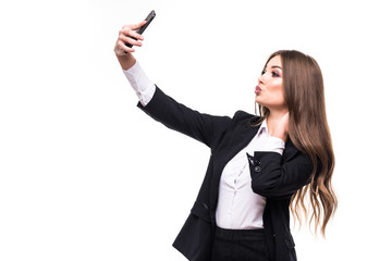 Closeup of beautiful playful business woman making selfie photo on white background and send kiss