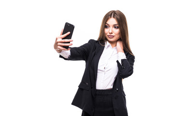 Beauty young business woman taking selfies with her smart phone on white background