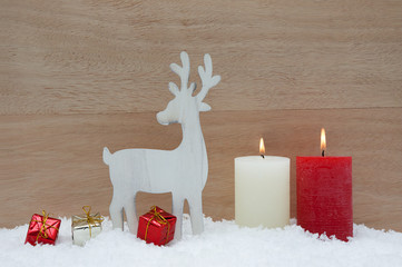 Christmas decorations with snow and wood background
