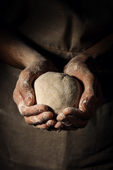 Cook holding dough sphere