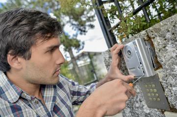 Man replacing an intercom system