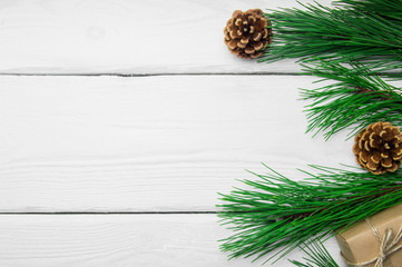 Branch christmas tree and cone on white wooden vintage background