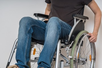 Handicapped disabled man sitting on wheelchair.