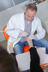 doctor podiatry removes calluses