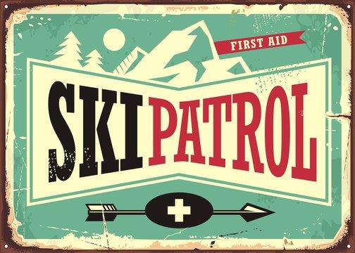 Ski patrol retro sign design with mountain shape and ski patrol text