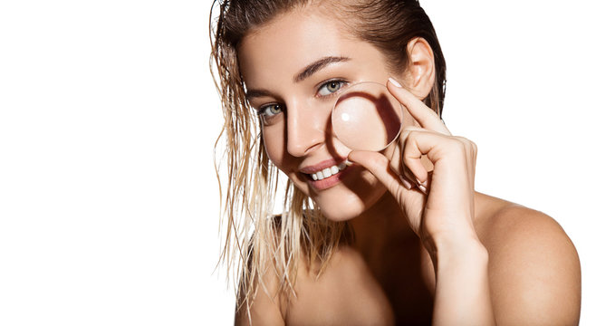 Glamour portrait of beautiful woman model with magnifying glass in her hands. Concept of healthy and beautiful skin. Beauty skin care, facial treatment and cosmetology concept.
