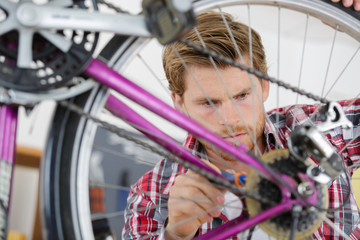 young handsome bicycle repairman