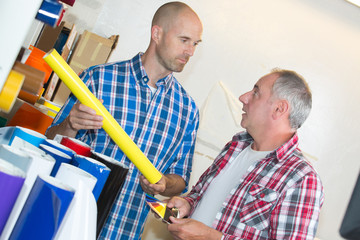 concentrated engineers thinking about best way to end project