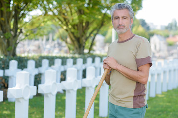 man in cemetary