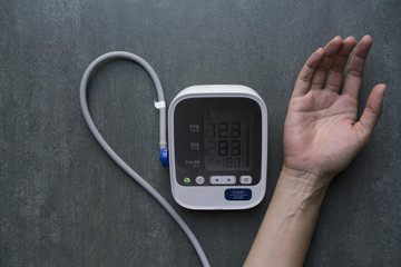 Measuring blood pressure and pulse while nervous, healthy concept