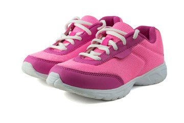 Womens pink sneakers with white laces isolated on white background.