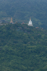 White big buddha aerial view with mountain background at Wat Prathat Phasornkaew, Khao Kho, Phetchabun, Thailand