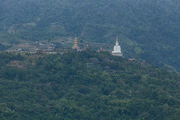 White big buddha aerial view with mountain background at Wat Prathat Phasornkaew, Khao Kho, Phetchabun, Thailand