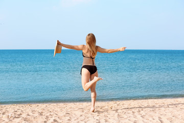 Young woman with nice body on sea beach