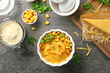 Ramekin with corn pudding on table