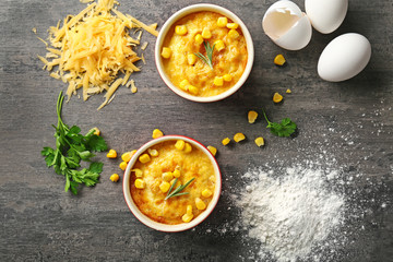 Ramekins with corn pudding and ingredients on table