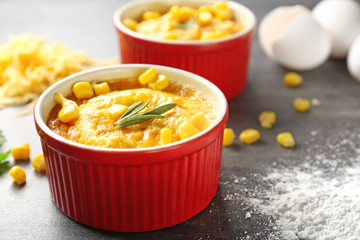 Ramekin with corn pudding on table