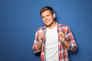Teenager boy in casual clothes on color background