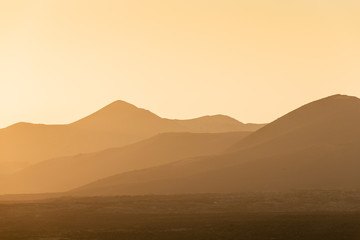 Lonely volcano in the national park of Timanfaya at sunset. Lanzarote. Canary Islands. Spain