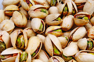 Pistachio texture. Nuts. Green fresh pistachios as texture. Roasted salted pistachio nuts healthy delicious food studio photo. Pattern.