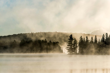 Lake of two rivers algonquin national park ontario canada sunset sunrise with fog foggy mystical...
