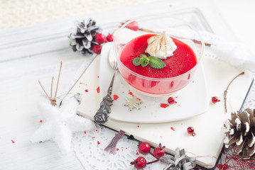 red fruit Panacotta with green mint leaves