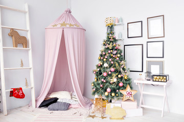 Hovel prepared for children. Beautiful New Year decor of the children room Christmas house.