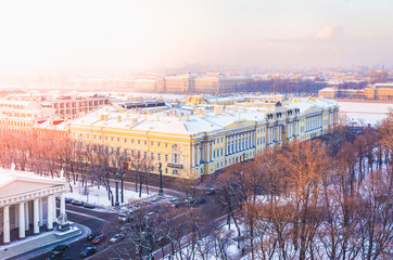 Winter urban landscape with the sun and the roofs of houses. The view from the top. Saint-Petersburg.