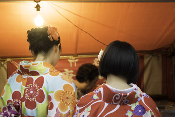 Women in traditional japanese kimonos shopping in the market.