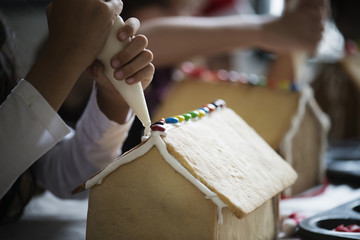 Kids making gingerbread houses