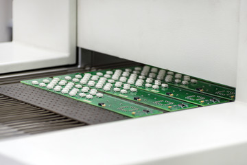Electronic printed circuit board at the output of air convection reflow oven